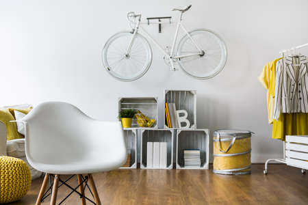 comfort room: White chair in modern design room with wood panels and white wall Stock Photo