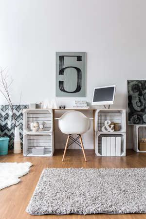 home office interior: Home office with original desk made from chipboard and wood boxes in spacious interior