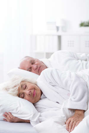 dressing gowns: Aged marriage sleeping together in dressing gowns