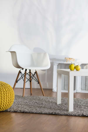 small table: Interior with stylish white chair and small table