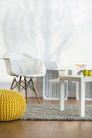 carpet and flooring: White furniture in light room with carpet and flooring Stock Photo