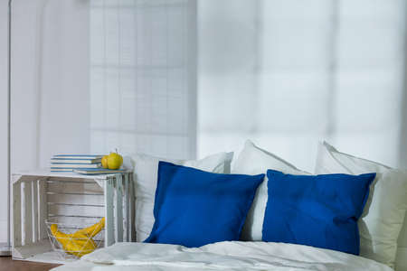 nightstand: Minimalistic bedroom with mattress and handmade nightstand