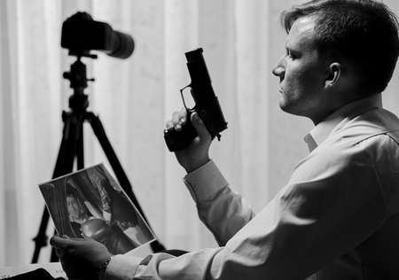 voyeur: Murderer wanting to kill somebody - black and white Stock Photo