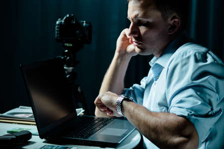 private detective: Private detective with laptop and camera at work Stock Photo