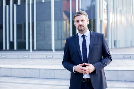 employees: Picture of confident male employee of big financial company Stock Photo