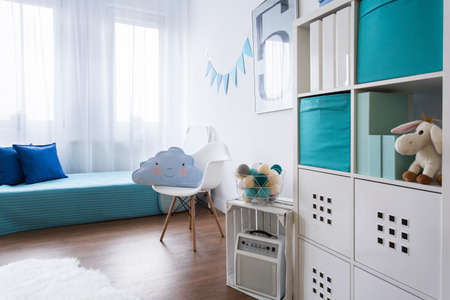 boy bedroom: Child bedroom in light colors with bed and modern shelving unit Stock Photo