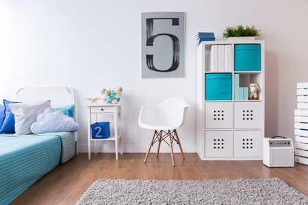 room decoration: Boy room in white and blue with flooring and carpet Stock Photo