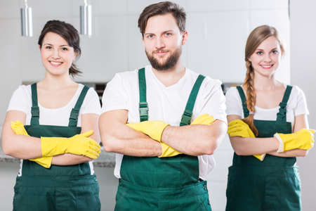 cleaning team: Professional cleaning team in uniforms