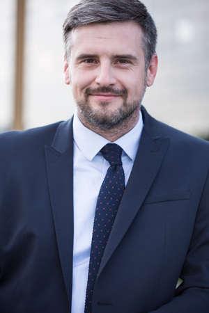 handsome guy: Portrait of content handsome businessman in elegant suit Stock Photo