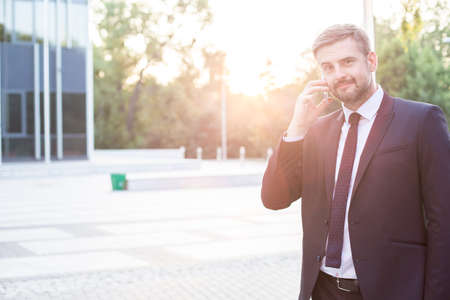 mobilephone: Photo of modern entrepreneur with mobilephone outdoor Stock Photo