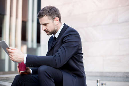 ambitious: Picture of ambitious office worker with digital tablet Stock Photo