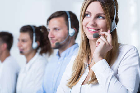teleoperator: Photo of female call agent working in tele service Stock Photo