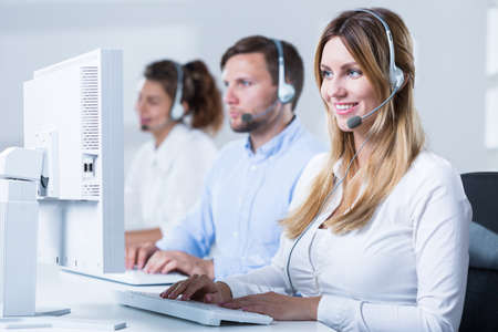 telephone saleswoman: Image of professional workers of telemarketing service Stock Photo