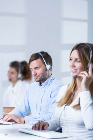 telephone saleswoman: Picture of teleoperators team of telesales center Stock Photo