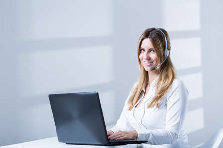 teleoperator: Photo of happy telesales center female consultant during work