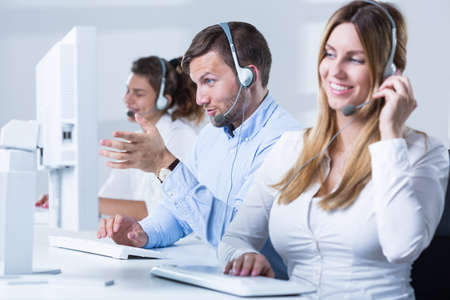telemarketer: Picture of female telemarketer with headset during work