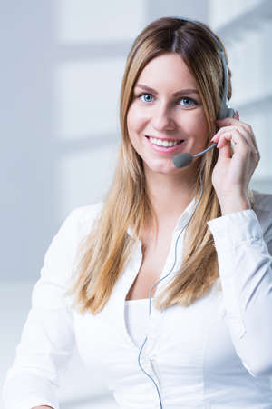 teleoperator: Portrait of smiling telesales worker with headset Stock Photo