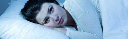 ger: Panorama of sad pensive female resting in ger bed Stock Photo