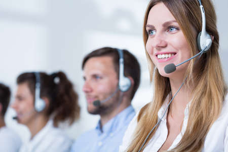 telephone saleswoman: Photo of female consultant with headset in call center