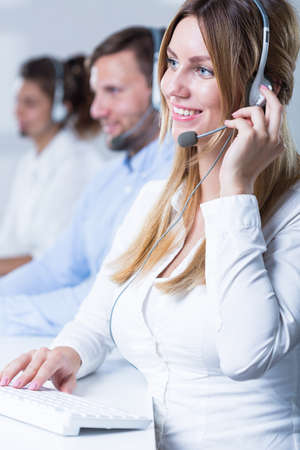 teleoperator: Image of team of telemarketers working in call center