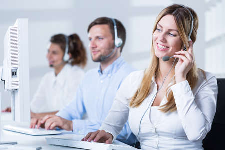 Image of professional workers of helpdesk service