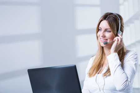 Picture of saleswoman talking on phone with customer Stock Photo