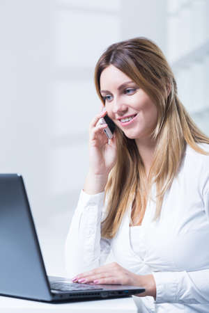 teleoperator: Photo of young saleswoman with headset and laptop Stock Photo