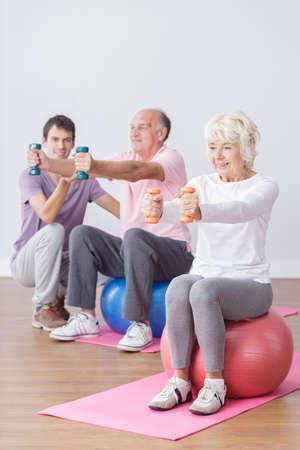 happy seniors: Happy exercising seniors and active healthy life Stock Photo