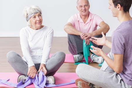 elastic: Happy active older couple and exercises with elastic bands Stock Photo