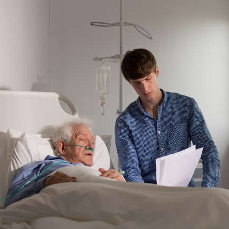 Terminally ill man reading the testament to his grandson