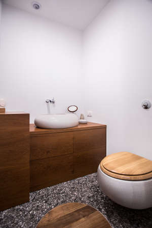handbasin: Light and stylish batroom with wooden decorations