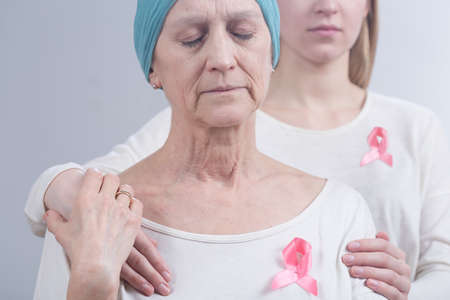 sick leave: Cancer woman and young girl with pink ribbon, embracing