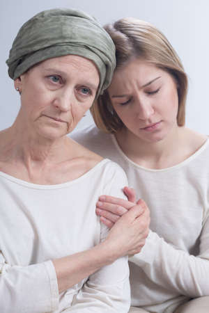 inner strength: Sad daughter supporting her ill mother with tumour during chemotherapy