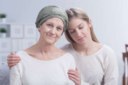 sick leave: Mature cancer woman embraced by young woman