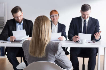 Corporations: Blonde woman applying for a job in corporation and members of management