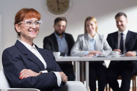company job: Mature woman applying for a job in corporation Stock Photo