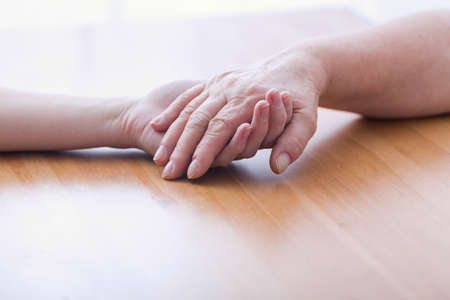 metaphor: Touching hands - metaphor of support and care Stock Photo