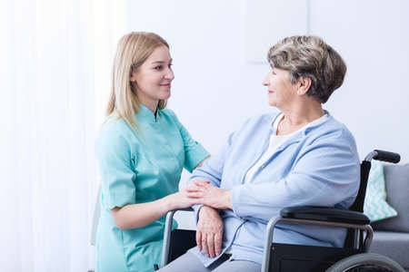 mobility nursing: Nurse caring about elder woman at home