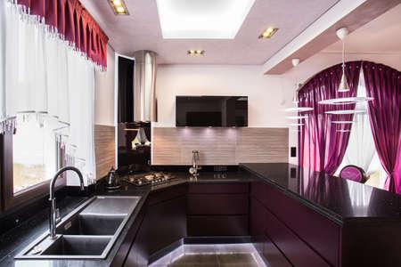 worktops: Brown cupboards and worktops in luxury kitchen Stock Photo