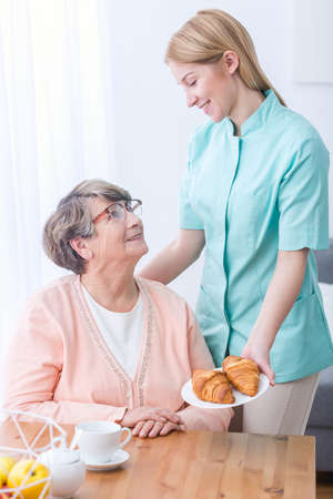 Senior woman and caregiver being in good humor