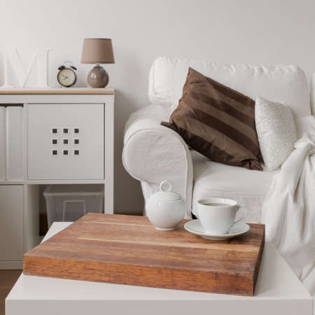 a close up: Close up of simple white coffee table