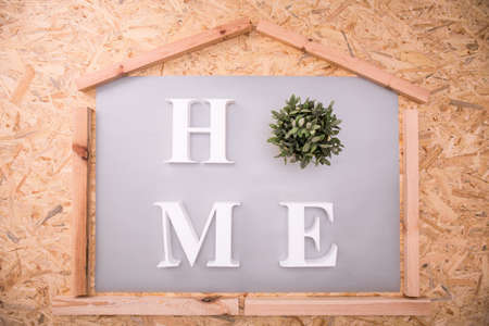 title: White home title and wooden decorations