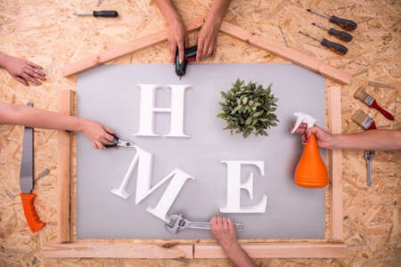 hardboard: Picture of home word on hardboard and tools