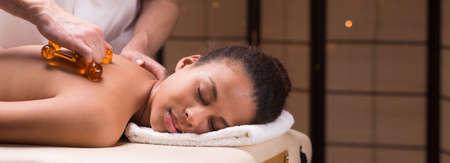 afroamerican: Panorama of afroamerican woman during spa treatment