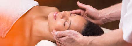 relax massage: Panorama of beauty having professional relaxing head massage Stock Photo