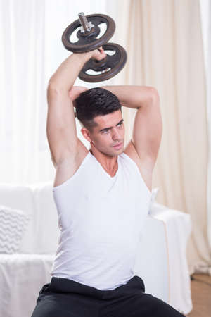 home trainer: Image of handsome healthy trainer during home workout