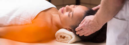 soothe: Panorama of young woman during relaxing massage in spa Stock Photo