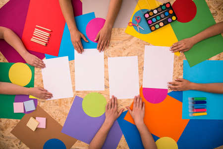 colored paper: Four pieces of white paper and school accessories