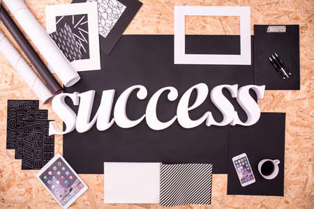title: White success title on black paper backboard Stock Photo