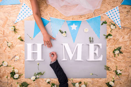 hardboard: Hands of young couple and home word Stock Photo